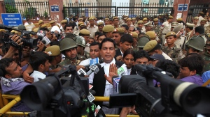 Defense lawyer A.P. Singh speaks to the media after a judge pronounced death sentences for all four men convicted in the rape and murder of a student on a moving New Delhi bus last year, in New Delhi, India, Friday, Sept. 13, 2013. (AP / Altaf Qadri)
