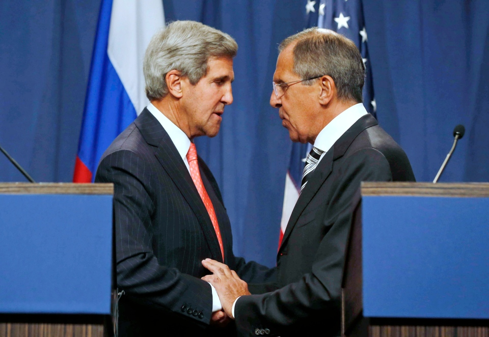U.S. Secretary of State John Kerry, left, and Russian Foreign Minister Sergei Lavrov, shake hands after making statements following meetings regarding Syria at a news conference in Geneva, Switzerland on Sept. 14, 2013. (AP / Larry Downing)