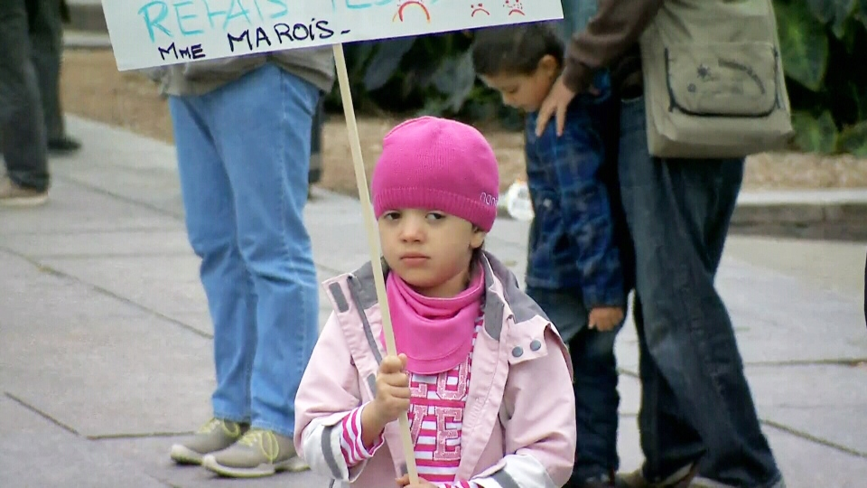A girl holds a sign at a protest against the proposed Quebec Charter of Values in Montreal on Saturday, Sept. 14, 2013.