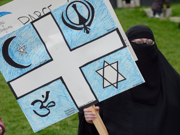 A woman takes part in a protest against Quebec's proposed Values Charter in Montreal on Saturday Sept. 14, 2013. (Ryan Remiorz / THE CANADIAN PRESS)