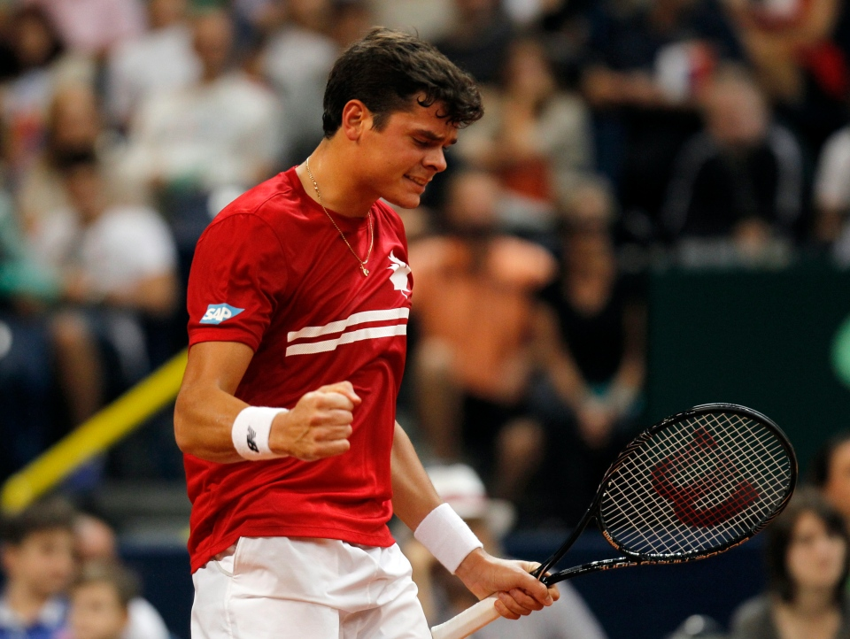Milos Raonic of Canada celebrates a point won against Novak Djokovic of Serbia during their Davis Cup semifinal tennis match in Belgrade, Serbia, Sunday, Sept. 15, 2013. (AP Photo/Darko Vojinovic)