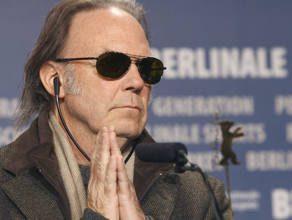 Singer songwriter Neil Young reacts during a news conference about his movie 'CSNY: Deja Vu' at the International Film Festival in Berlin, Germany, Feb. 8, 2008. (AP / Markus Schreiber)