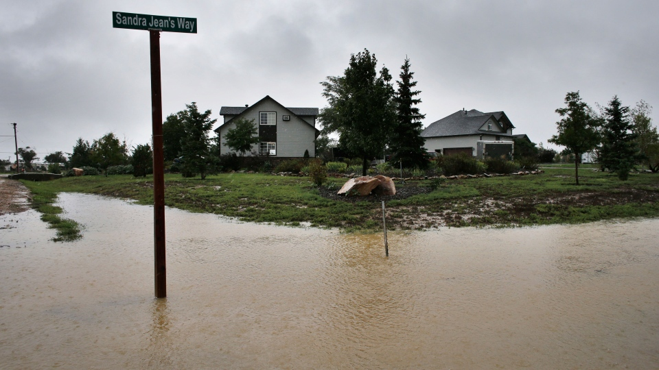 As heavy rains return after somewhat abating for two days, a field fills with water from overflowing creeks nearby, outside Longmont, Colo., Sunday, Sept. 15, 2013. (AP / Brennan Linsley)