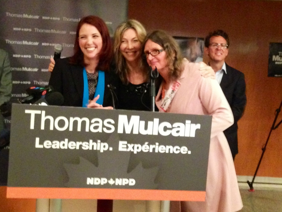 Journalist Linda McQuaig, centre, poses with the runners up after winning the NDP nomination in Toronto Centre Sunday, September, 15, 2013. (Cristina Tenaglia /CP24)
