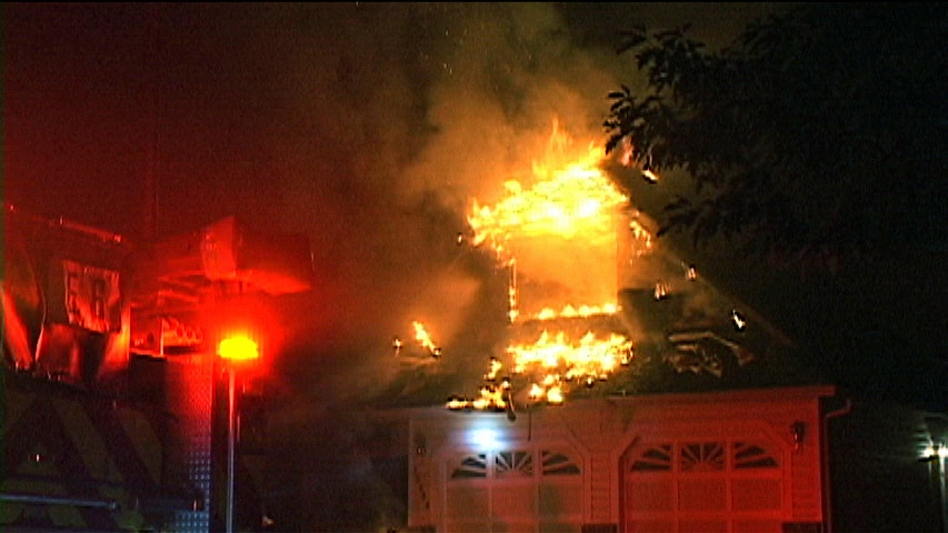 Firefighters work to extinguish a fatal fire that broke out at a home in the 9400-block of 57 Avenue in Surrey, B.C. Sept. 15, 2013. (CTV)