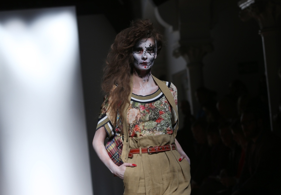 A model wears a design created by Vivienne Westwood during London Fashion Week Spring/Summer 2014, at the German Gymnasium in Kings Cross, north London, Sunday, Sept. 15, 2013. (Invision / Joel Ryan)