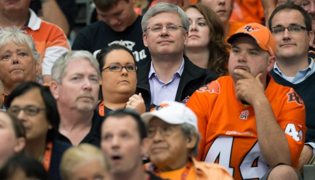 Prime Minister Stephen Harper at CFL game.
