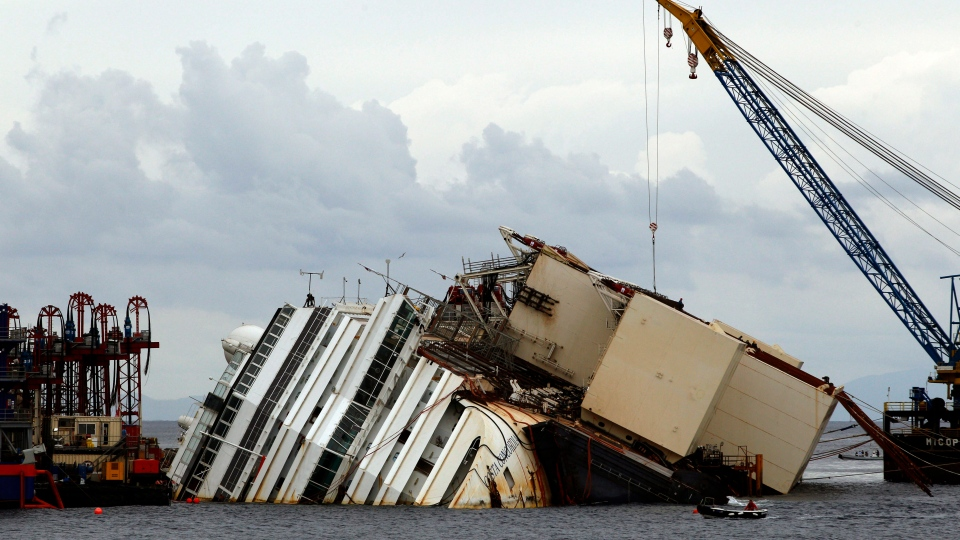 The Costa Concordia ship lies on its side on the Tuscan Island of Giglio, Italy, Sunday, Sept. 15, 2013. (AP / Andrew Medichini)