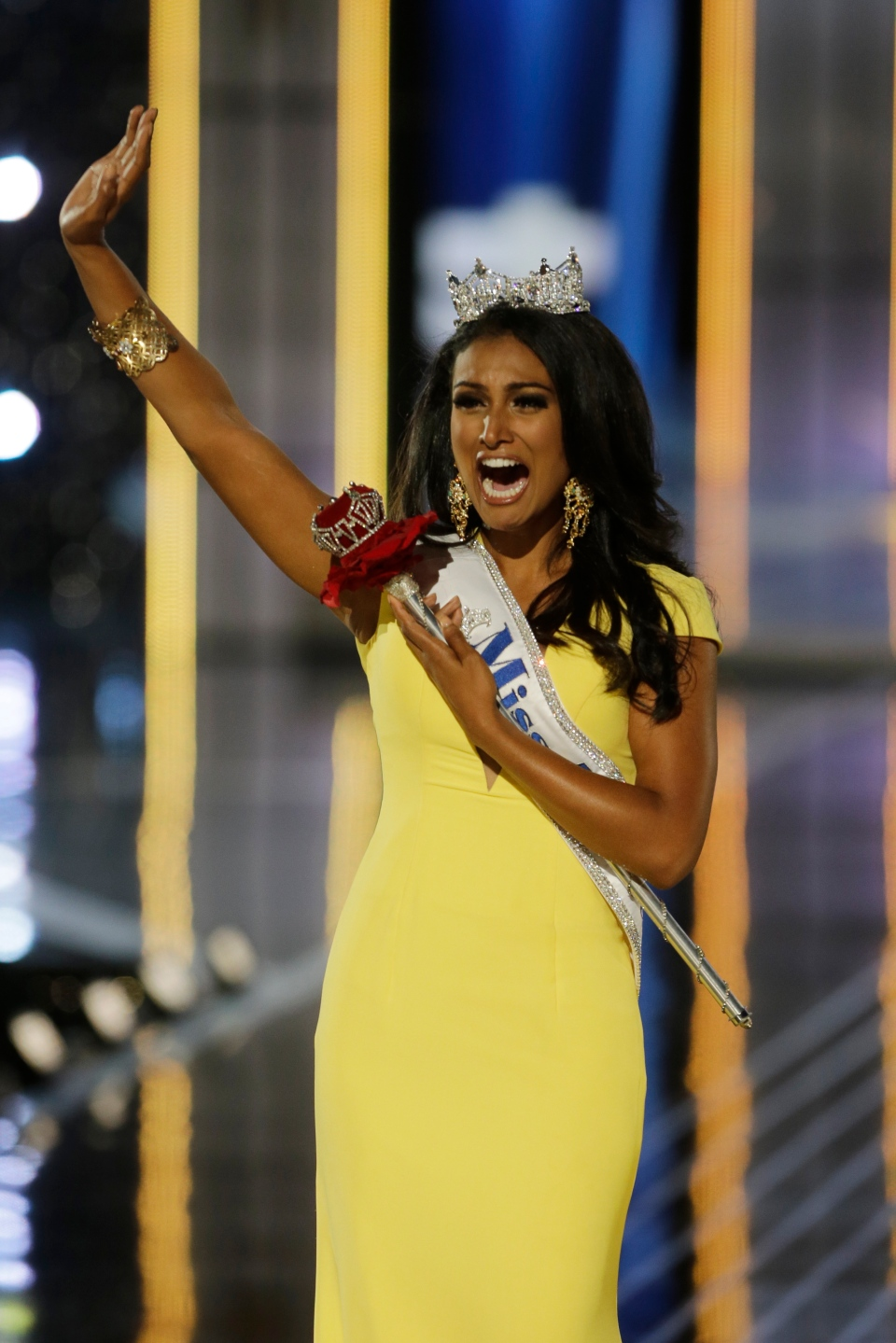 Miss New York Nina Davuluri walks down the runway after winning the Miss America 2014 pageant, Sunday, Sept. 15, 2013, in Atlantic City, N.J. (AP / Mel Evans)