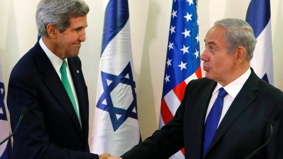 U.S. Secretary of State John Kerry, left, shakes hands with Israel's Prime Minister Benjamin Netanyahu at the prime minister's office in Jerusalem, Israel, Sunday, Sept. 15, 2013. (AP / Larry Downing)