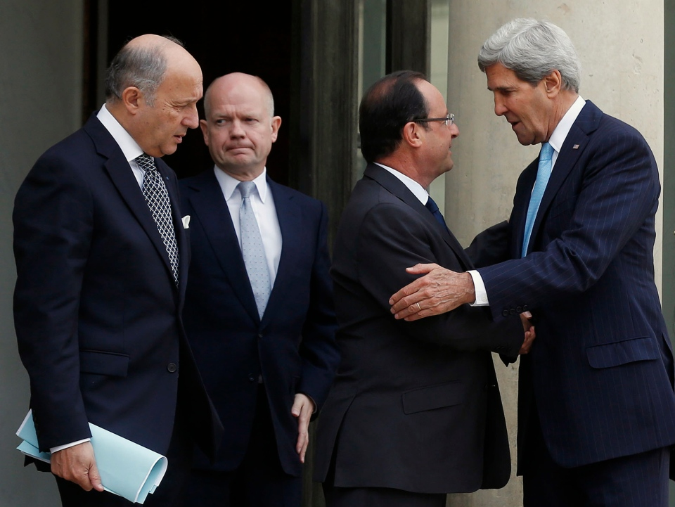 U.S. Secretary of State John Kerry, right, speaks with French President Francois Hollande, second from right, before taking leave as French Foreign Minister Laurent Fabius, left, and British Foreign Secretary William Hague stand alongside following their meeting on Syria, at the Elysee palace, Paris, Monday, Sept. 16, 2013. (AP / Larry Downing)