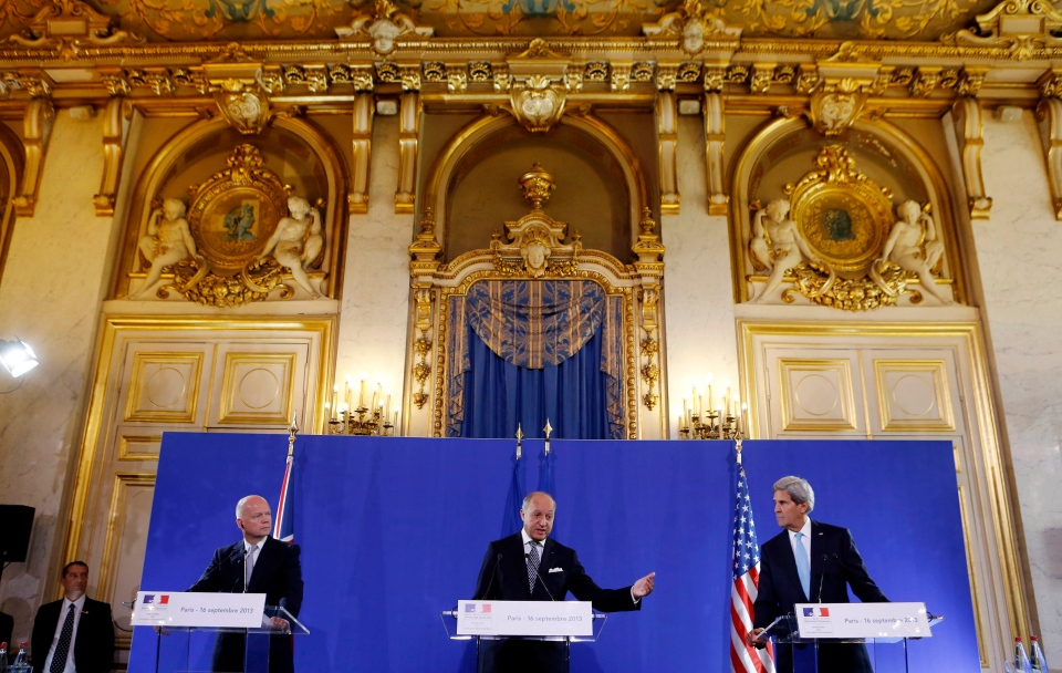 U.S. Secretary of State John Kerry, right, and British Foreign Secretary William Hague, left, listen to French Foreign Minister Laurent Fabius speak at a news conference after a meeting on Syria, at the Quai d'Orsay, Paris, Monday, Sept. 16, 2013. (AP / Larry Downing)