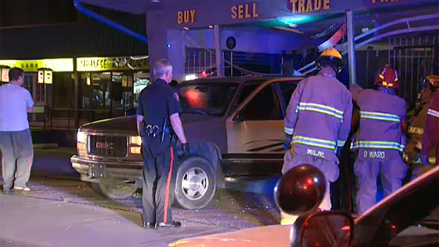 Police were called to the scene of this pawn shop on Monday morning after a pickup truck was found crashed through the front entrance.