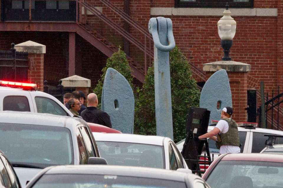 Police bring in equipment by an anchor outside of an entrance to the Washington Navy Yard where a gunman was reported in Washington, on Monday, Sept. 16, 2013. (AP / Jacquelyn Martin)