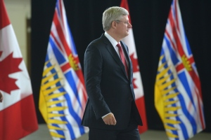 Prime Minister Stephen Harper enters a news conference in Richmond, B.C. on Monday, Sept. 16, 2013. (THE CANADIAN PRESS/Jonathan Hayward)