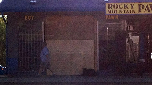 A pawn shop on Macleod Trail is boarded up after it was hit by thieves who back a truck into the entrance of the store early Monday morning.
