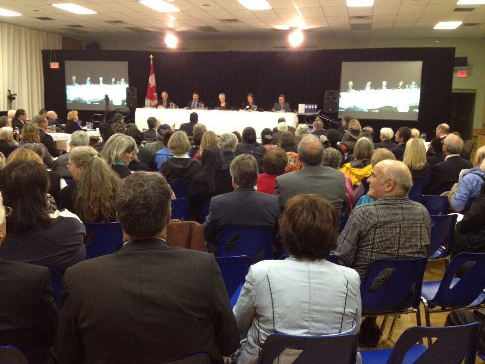 People gather for hearings into a proposed Ontario Power Generation nuclear waste facility in Kincardine, Ont., on Monday, Sept. 16, 2013. (Scott Miller / CTV London)