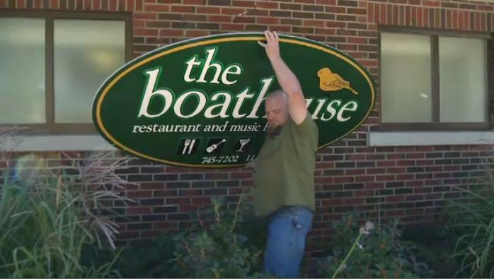 Kevin Doyle removes a sign from the outside of the Boathouse in Kitchener, Ont., on Monday, Sept. 16, 2013.