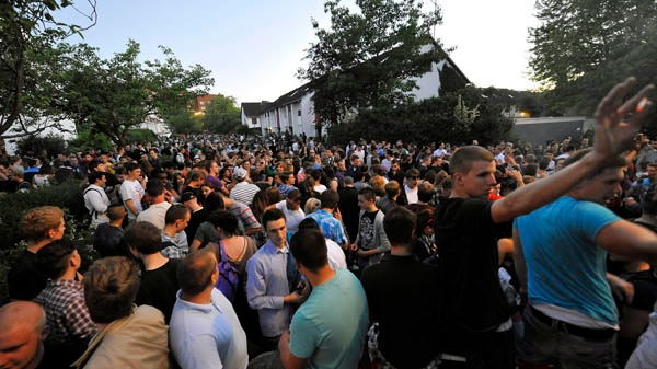 Party goers gather in Hamburg, Germany after a teenage girl, identified only as Thessa, forgot to mark her birthday invitation as private on Facebook, Friday, June 3, 2011. (AP / dapd / Stefan Simonsen)