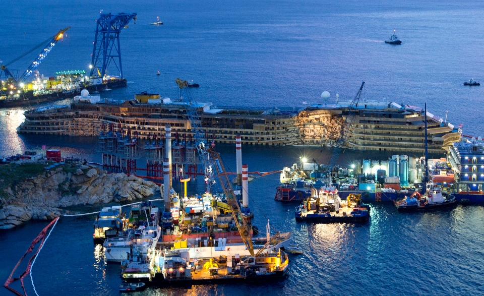 The Costa Concordia after it was lifted upright, on the Tuscan Island of Giglio, Italy, early Tuesday morning, Sept. 17, 2013. (AP / Andrew Medichini)