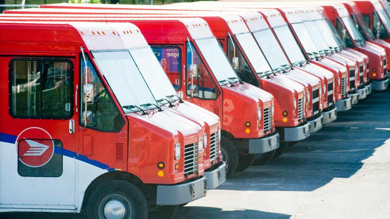 Canada Post vehicles sit idle outside a sorting depot in the borough of Ville St. Laurent in Montreal, Monday, June 6, 2011. (Graham Hughes / THE CANADIAN PRESS)