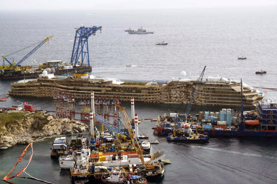 The Costa Concordia, after it was lifted upright, on the Tuscan Island of Giglio, Italy, Tuesday, Sept. 17, 2013. (Alessandro La Rocca / Lapresse)
