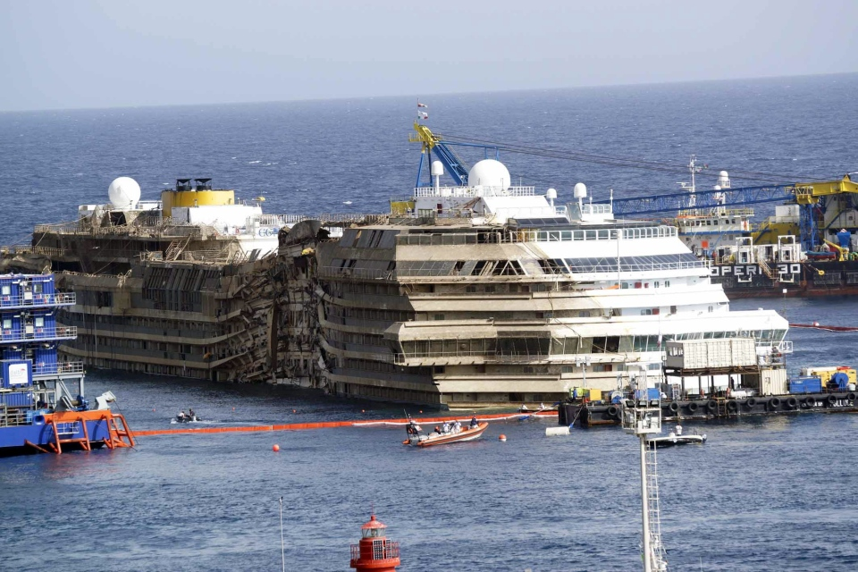 The Costa Concordia ship is seen after it was lifted upright, on the Tuscan Island of Giglio, Italy, Tuesday morning, Sept. 17, 2013. (AP / Alessandro La Rocca, Lapresse)