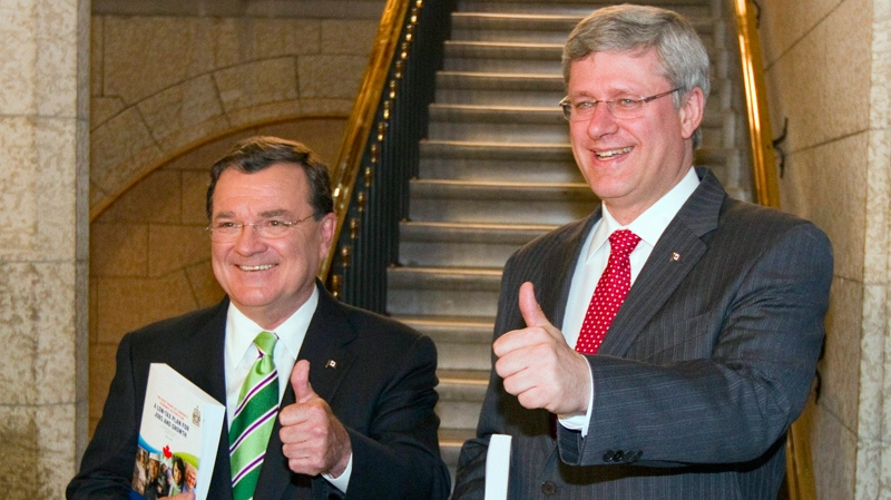 Finance Minister Jim Flaherty and Prime Minister Stephen Harper make their way to the House of Commons to deliver the budget speech in Ottawa, Monday, June 6, 2011. (Fred Chartrand / THE CANADIAN PRESS)