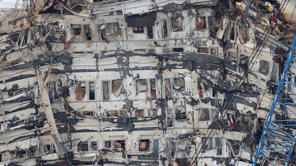 A detail of the previously submerged side of the Costa Concordia is seen after it was lifted upright, on the Tuscan Island of Giglio, Italy, Tuesday, Sept. 17, 2013. (Andrea Sinibaldi, Lapresse)
