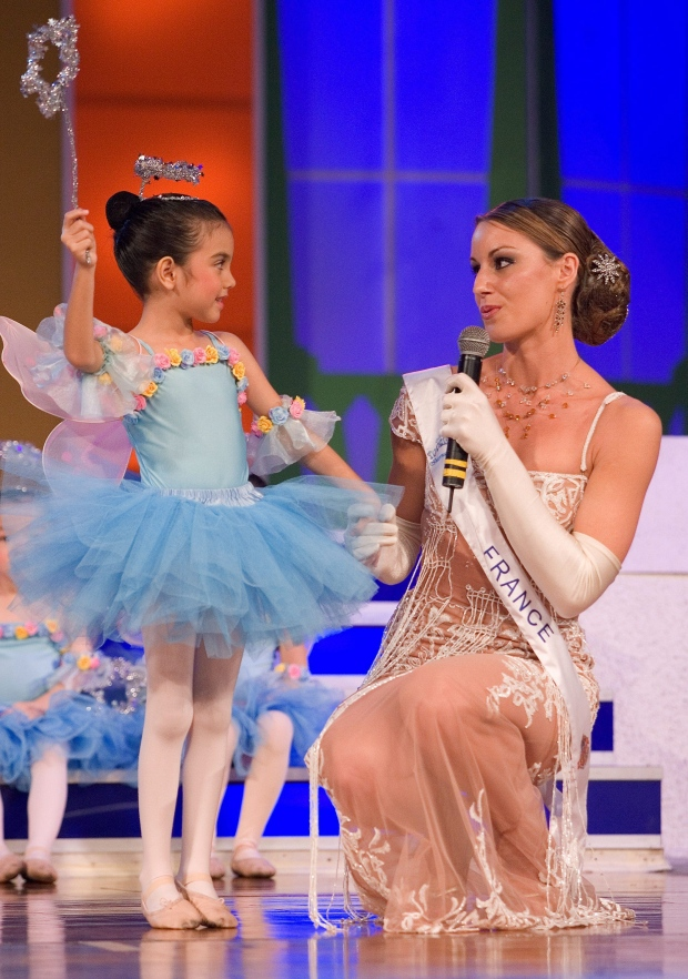 France's Isabelle Lamant performs with a child