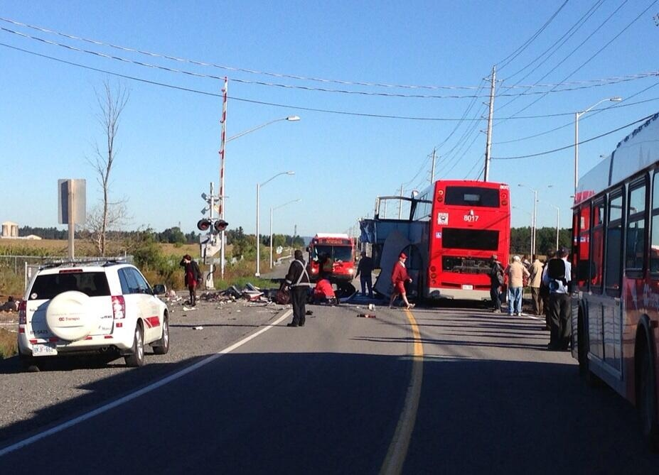 Police say an OC Transpo double decker bus has been hit by a train at the Woodroffe and Fallowfield intersection. (Darryl Praill / Twitter)