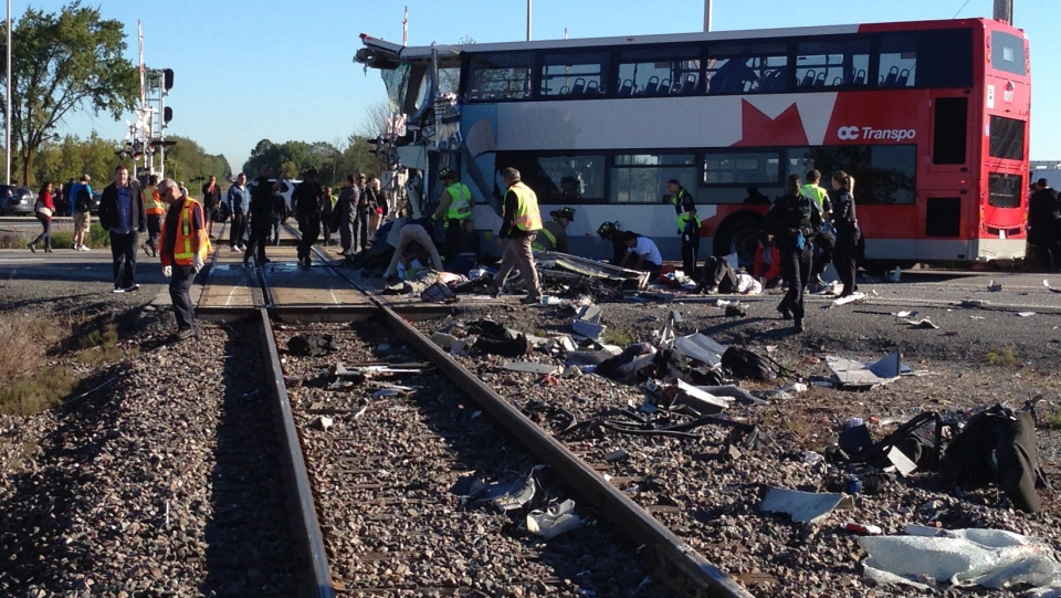 A Via Rail train and a city bus collided in Ottawa's west end Wednesday, Sept. 18, 2013. (Terry Pedwell / THE CANADIAN PRESS)