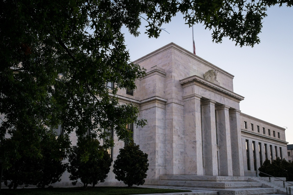 The U.S. Federal Reserve headquarters stands in Washington on Sept. 18, 2013. During its policy meeting on Wednesday, the Federal Reserve is expected to take its first step toward slowing the economic stimulus it's supplied since the financial crisis and the Great Recession five years ago. (AP Photo/J. David Ake)