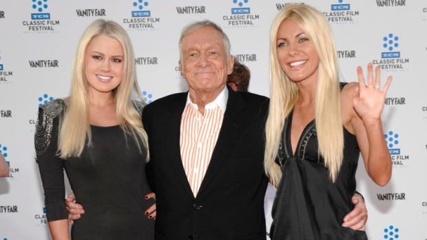Model Anna Berglund, left, Hugh Hefner, centre, and model Crystal Harris arrive at the world premiere of the newly restored feature film 'An American in Paris' during the opening night of the TCM Classic Film Festival in Los Angeles on Thursday, April 28, 2011. (AP / Dan Steinberg)