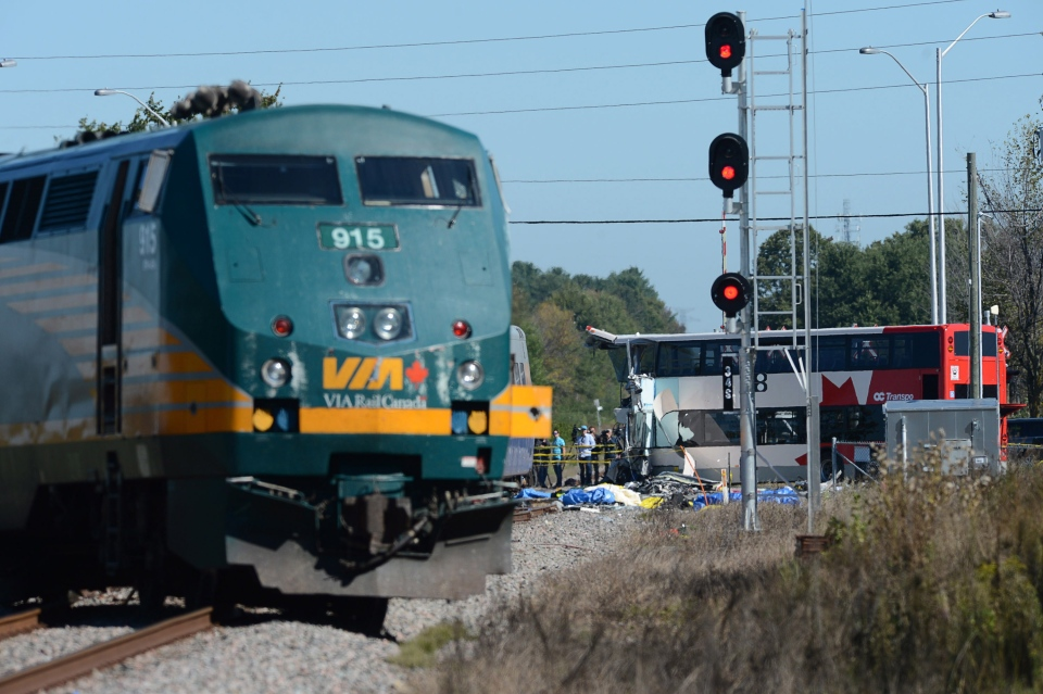 A Via Rail train sits derailed after colliding with a double-decker transit bus in Ottawa's west end, Wednesday, Sept. 18, 2013. (Sean Kilpatrick / THE CANADIAN PRESS)