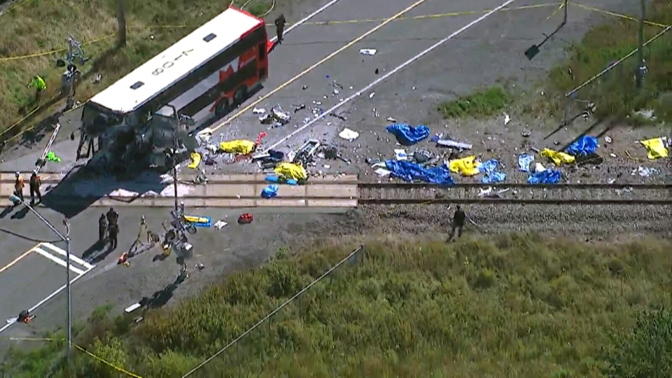 The destruction caused by the Via Rail train and a double-decker OC Transpo bus collision is visible in this aerial view from the CTV News helicopter over the scene in Ottawa, Wednesday, Sept. 18, 2013.