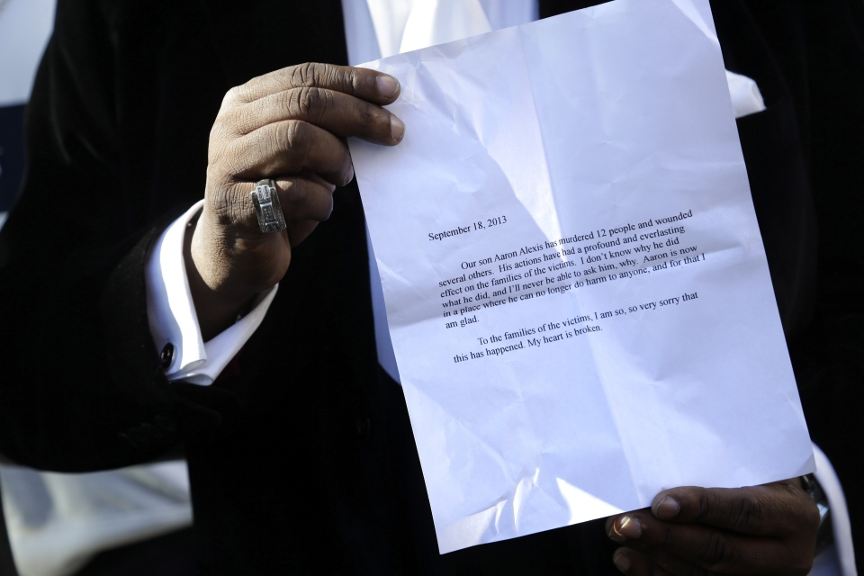 Bishop Gerald Seabrooks shows a statement made by Cathleen Alexis, mother of Washington Navy Yard gunman Aaron Alexis, in New York's Brooklyn borough on Wednesday, Sept. 18, 2013. (AP / Seth Wenig)