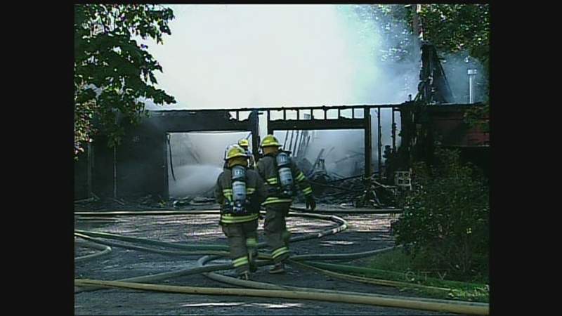 Firefighters battle a blaze at a residence on Marion Street in Dorchester, Ont. on Wednesday, Sept. 18, 2013.