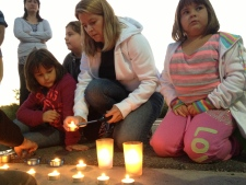 Candlelight vigil for bus and train collision