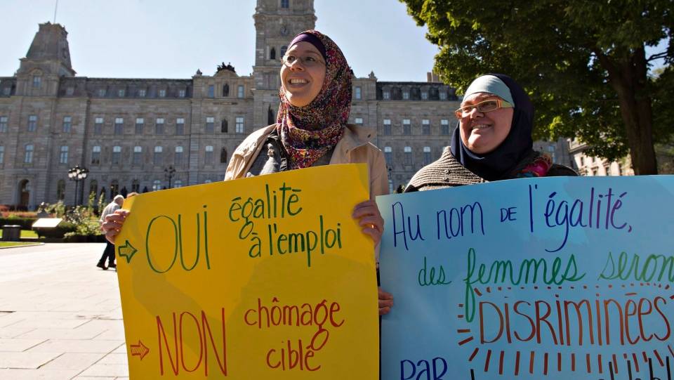 Two Muslim women demonstrate against the proposed Quebec charter of values at the legislature in Quebec City on Tuesday, September 17, 2013. (Jacques Boissinot / THE CANADIAN PRESS)
