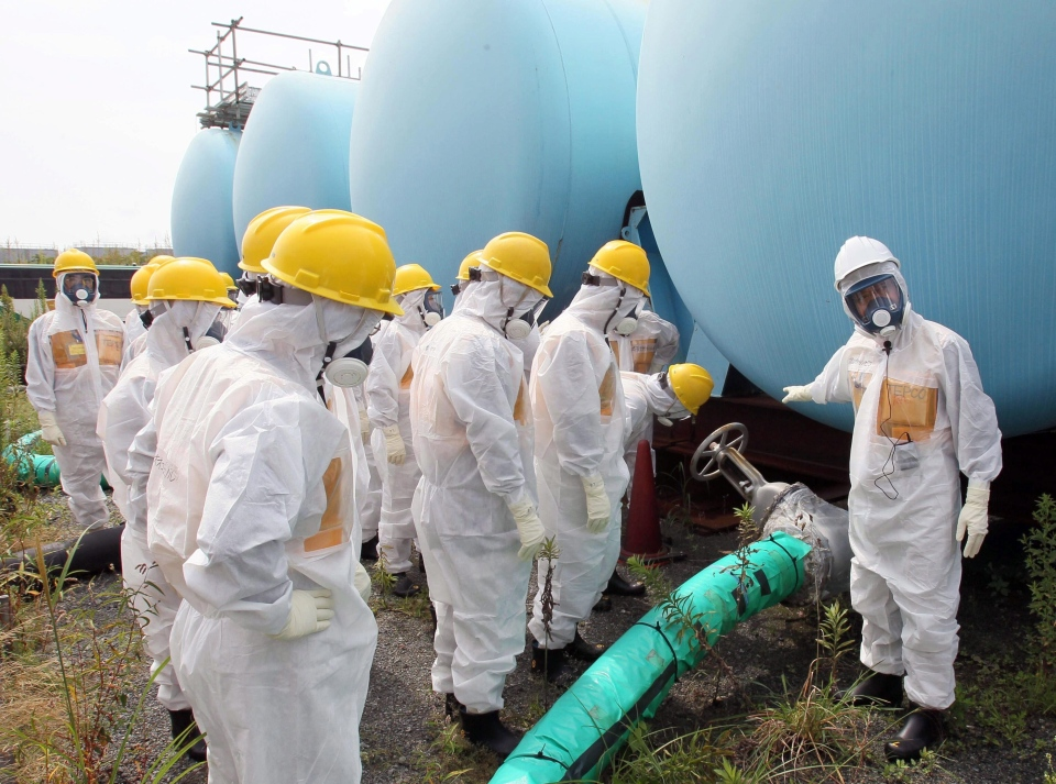 Members of a prefectural committee on the Fukushima Dai-ichi nuclear plant inspect tanks holding toxic water at the tsunami-crippled plant in Okuma town, Fukushima prefecture, northeastern Japan, on Friday, Sept. 13, 2013. (AP / Kyodo News)