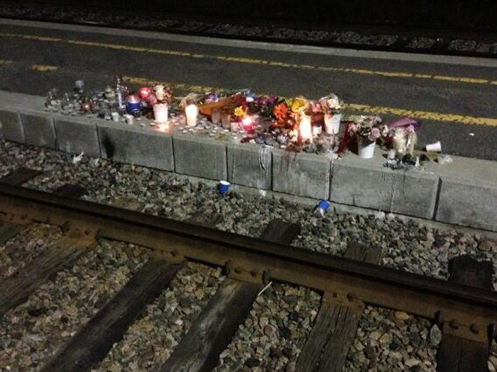 A makeshift memorial was set up along the VIA Rail tracks at Fallowfield station on September 18, 2013. The City of Ottawa is talking to the families of the six people killed in the tragedy about plans for a permanent memorial.