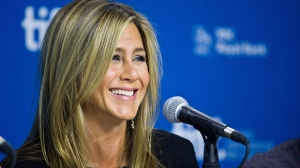 Jennifer Aniston smiles during a press conference for 'Life of Crime' at the 2013 Toronto International Film Festival in Toronto on Saturday, Sept. 14, 2013. (Galit Rodan / THE CANADIAN PRESS)