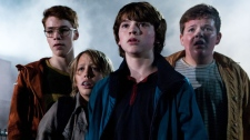 In this film publicity image released by Paramount Pictures, Gabriel Basso, Ryan Lee, Joel Courtney and Riley Griffiths are shown in a scene from 'Super 8.' (Paramount Pictures, Francois Duhamel)