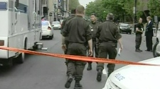 Montreal police were reportedly pursuing a knife-wielding man who was strewing garbage bags around, Tuesday, June 7, 2011.