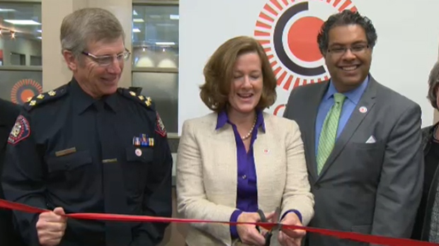 Police Chief Rick Hansen, Premier Alison Redford and Mayor Naheed Nenshi  take part in the ribbon cutting ceremony at SORCe