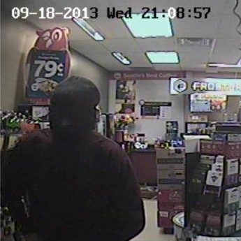 Surveillance video of the suspect in Huntsville robbery (OPP Handout)
