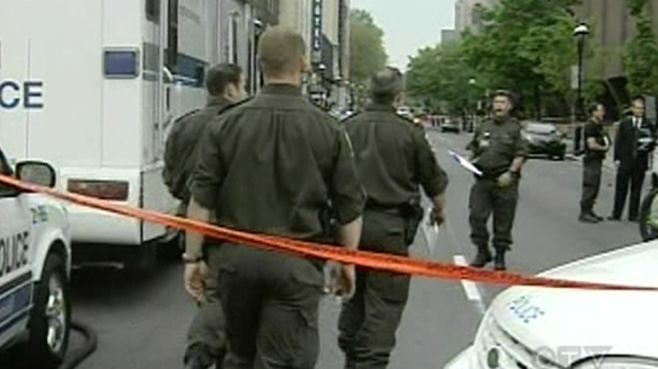 Surete du Quebec officers took over the investigation involving Montreal police shooting two people (June 7, 2011)