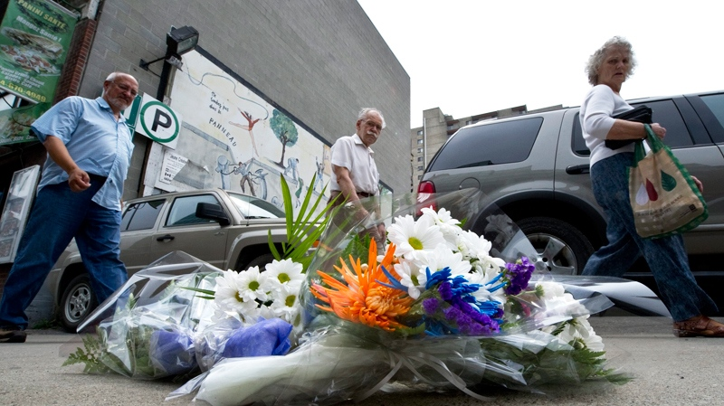 Flowers mark the site where hospital worker Patrick Limoges, 36, an innocent bystander, was shot by Montreal police after officers opened fire on Tuesday and killed a knife-wielding homeless man, in Montreal, Wednesday, June 8, 2011. (Paul Chiasson / THE CANADIAN PRESS)