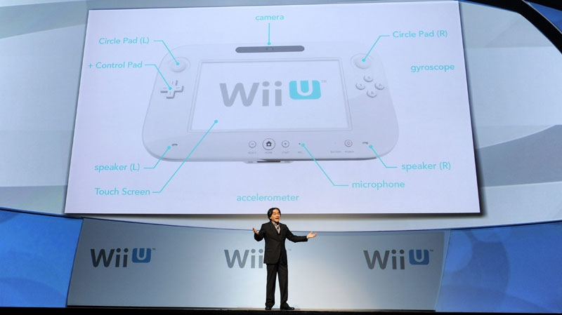 Satoru Iwata, President of Nintendo Co., Ltd., discusses their new gaming console the Wii U during a news conference at the E3 Gaming Convention in Los Angeles, Tuesday, June 7, 2011. (AP Photo/Chris Pizzello)